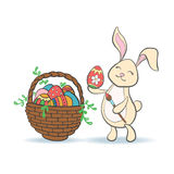 Cute Easter Bunny with colorful egg and brush. Royalty Free Stock Photo