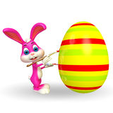 Cute Easter Bunny coloring big egg Stock Photography