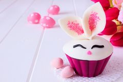 Easter bunny cupcake, close up with decor over white wood royalty free stock photography