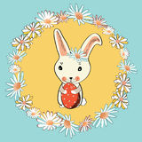 Cute Easter bunny with Easter egg in the middle of floral wreath. Vector illustration on blue background. Hand drawn cute Easter bunny with red Easter egg in the stock illustration