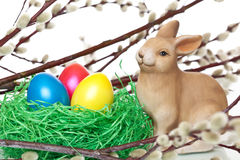 Cute Easter bunny near Easter nest with eggs Royalty Free Stock Image