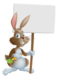 Cute Easter bunny rabbit carrot sign Stock Photo
