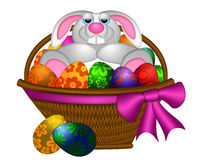 Cute Easter Bunny Rabbit Laying in Egg Basket Stock Photography