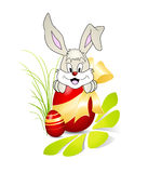 Cute Easter Bunny With Red Egg And Golden Bow Stock Images