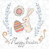 Cute easter card with easter bunny holding egg Stock Image