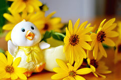 Cute Easter chicken and flowers Stock Image