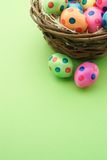 Cute easter eggs with green background and copy space. Cute easter eggs in a nest with green background and copy space Stock Image