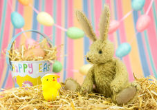 Cute Easter friends.Toy bunny rabbit, chick and bucket. Stock Images