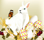 Cute Easter bunny sit in nest with eggs Stock Photography