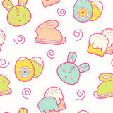 Cute Easter seamless pattern with Easter eggs, rabbit, Easter bunny and Easter cakes Stock Images