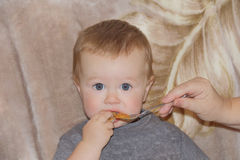 Cute eating baby 1 year. Image of cute eating baby 1 year Stock Photo
