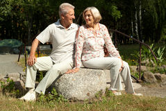 Cute elderly couple  in the garden Stock Images