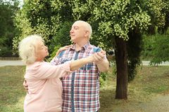 Cute elderly couple in love dancing royalty free stock image