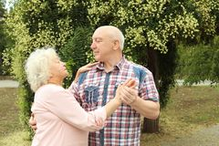 Cute elderly couple in love dancing royalty free stock photo