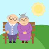 Cute elderly couple sitting on the bench in sunny day Stock Images