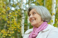 Cute elderly woman in the park Royalty Free Stock Images