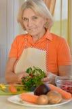 Cute elderly woman preparing Royalty Free Stock Photography
