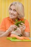 Cute elderly woman preparing Stock Image