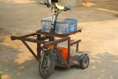 Cute electric tricycle, used in a wonderful and creative seafood restaurant to transport food from the kitchen to the outdoor dine stock image