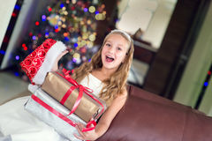 Cute elegant girl celebrate Christmas and New Year with presents Royalty Free Stock Photography