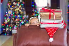 Cute elegant girl celebrate Christmas and New Year with presents Stock Images