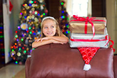 Cute elegant girl celebrate Christmas and New Year with presents Royalty Free Stock Image