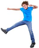 Cute elementary boy  jumping and dancing over white Stock Photo