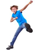 Cute elementary boy  jumping and dancing over white Royalty Free Stock Photos