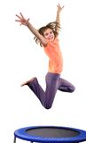 Cute elementary girl jumping and dancing over white Royalty Free Stock Images