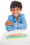 Cute elementary pupil smiling at camera Royalty Free Stock Images