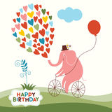 Cute elephant on a bike Royalty Free Stock Images