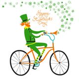 Cute elf leprechaun on city bicycle with clover Stock Photography