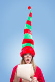Cute elf shocked by the Christmas naughty list Stock Photo