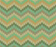 Cute Ethnic Autumn Knitted Abstract Geometric Zigzag Pattern in Green, Orange, Brown and Beige Royalty Free Stock Photography