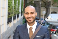Cute ethnic bald man wearing a suit stock images