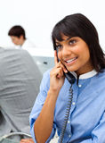 Cute ethnic businesswoman on phone Stock Photography