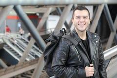 Cute ethnic man wearing leather jacket royalty free stock photo