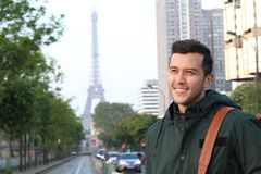 Cute ethnic young man in Paris, France royalty free stock image