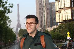 Cute ethnic young man in Paris, France royalty free stock photos