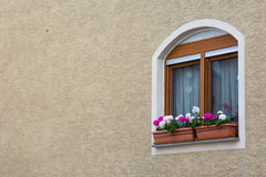 Cute European WIndow on Stucco Wall Texture Background with Copy Royalty Free Stock Photo