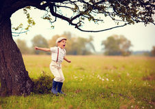Cute excited boy having fun on spring field, countryside Royalty Free Stock Photography