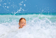 Cute excited boy having fun in waves, summer vacation Royalty Free Stock Photos