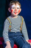 Cute excited little boy in comic red makeup Royalty Free Stock Photos