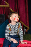 Cute excited little boy in comic red makeup Stock Photos