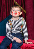 Cute excited little boy in comic red makeup Royalty Free Stock Photo