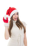 Cute excited teenage girl with Santa hat Royalty Free Stock Images