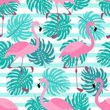 Cute exotic tropical seamless background with cartoon characters of pink flamingos. And palm leaves for your decoration Royalty Free Stock Photos