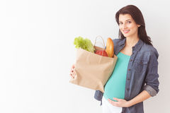 Cute expectant mother is going shopping Stock Images