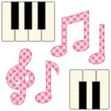 Cute fabric music notes and piano keys as applique in shabby chic style. For scrap booking, as decorative elements for country music events Stock Photo