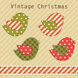 Cute fabric paradise birds as retro fabric applique in shabby chic style in traditional Christmas colors Royalty Free Stock Photography